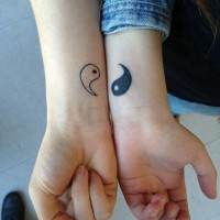 Small friendship tattoos ying yang on wrists