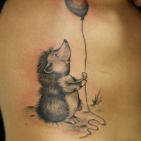 Small gray-ink hedgehog with balloon tattoo on ribs