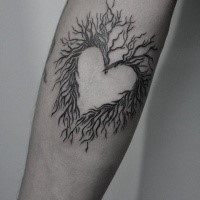 Small heart shaped arm tattoo of tree branches
