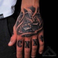 Small illustrative style hand tattoo of playing cards with dice