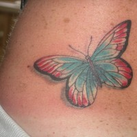 Small lower back butterfly tattoo design for girls