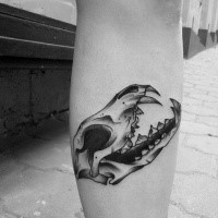 Small new school style leg tattoo of old animal skull with teeth