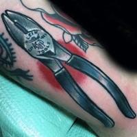 Small nice looking lineman tools tattoo on arm