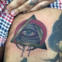 Small old school style colored mystical pyramid with red moon tattoo on thigh