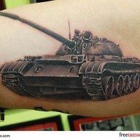 Small realistic looking biceps tattoo of cool looking tank