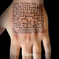 Small simple black ink hand tattoo of cool labyrinth