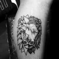 Small simple dot style leg tattoo of lion head