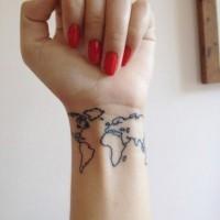 Small size dark black ink world map contour tattoo on wrist