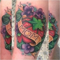 Small sweet looking colored tattoo of big tomato with lettering