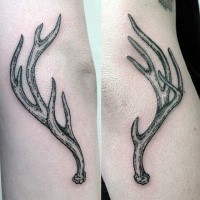 Small typical engraving style elbow tattoo