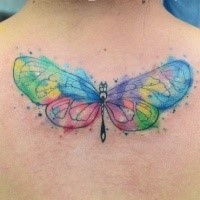 Small watercolor style colored butterfly tattoo on upper back