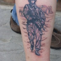 Soldier with guns tattoo on leg