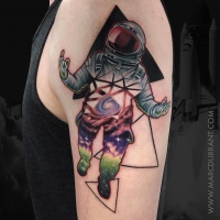 Spaceman tattoo on shoulder
