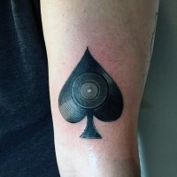Spades symbol stylized with vinyl record original idea tattoo