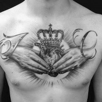 Spectacular black and white chest tattoo of hands holding heart and crown