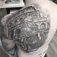 Spectacular black ink detailed looking gladiator tattoo on back combined with ancient Roman arena
