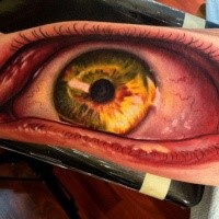Spectacular colored biceps tattoo of creepy human eye