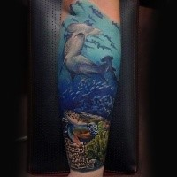 Spectacular colored forearm tattoo of underwater sharks and turtle