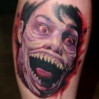 Spectacular colored tattoo of creepy zombie monster face