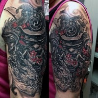 Spectacular designed and colored shoulder tattoo of samurai mask with dragon and flower