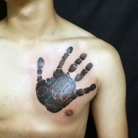 Spectacular looking 3D style dark hand tattoo on chest stylized with red symbols