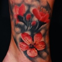 Spectacular looking colored ankletattoo of beautiful flower