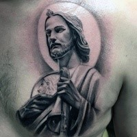 Spectacular looking colored chest tattoo of Jesus statue