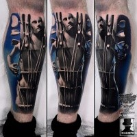Spectacular looking colored leg tattoo of human shaped guitar