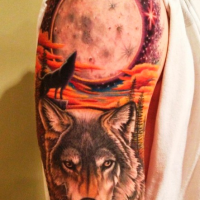 Spectacular looking colored shoulder tattoo of of wolf with big moon