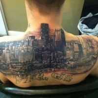 Spectacular multicolored upper back tattoo of big city sights and lettering