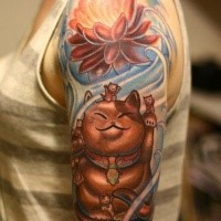 Spectacular painted and colored shoulder tattoo of maneki neko japanese lucky cat statue with big flower