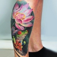 Spectacular realism style colored leg tattoo of frog with flower