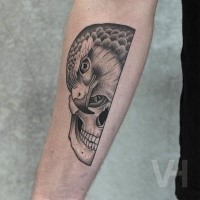 Spectacular Valentin Hirsch usual style arm tattoo of human skull and eagle head