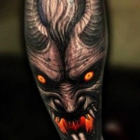 Spooky demon with red eyes tattoo