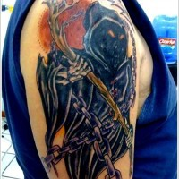 Spooky grim reaper tattoo on shoulder