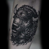 Stippling style back ink arm tattoo of cool looking bull with flowers