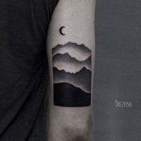 Stippling style black ink arm tattoo of mountains with moon