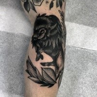 Stippling style black ink arm tattoo of black bull with leaves
