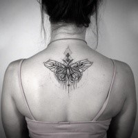 Stippling style black ink back tattoo of butterfly with ornaments