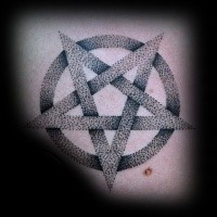 Stippling style black ink demonic star tattoo combined with circle