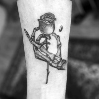 Stippling style black ink tattoo of skeleton hand holding rose