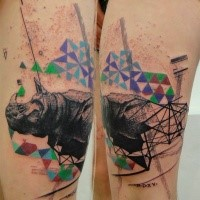 Stippling style colored thigh tattoo of rhino with geometrical ornaments