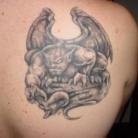 Stone gargoyle tattoo on shoulder blade