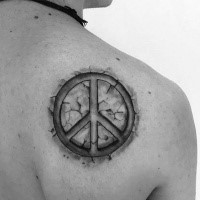 Stone like black and white shoulder tattoo of pacific symbol