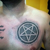 Stone like colored chest tattoo of creepy looking demonic star