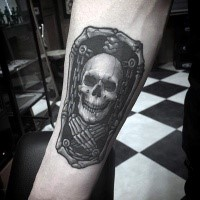 Stonework style amazing looking forearm tattoo of little portrait with skeleton and chains