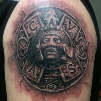 Stonework style colored shoulder tattoo of Aztec tablet