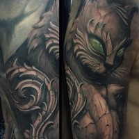 Stonework style detailed looking shoulder tattoo of cat statue with green eyes