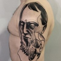 Strange looking black ink painted by Michele Zingales upper arm tattoo of demonic man face and skull
