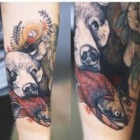 Strange looking colored by Joanna Swirska forearm tattoo of bear head with fish